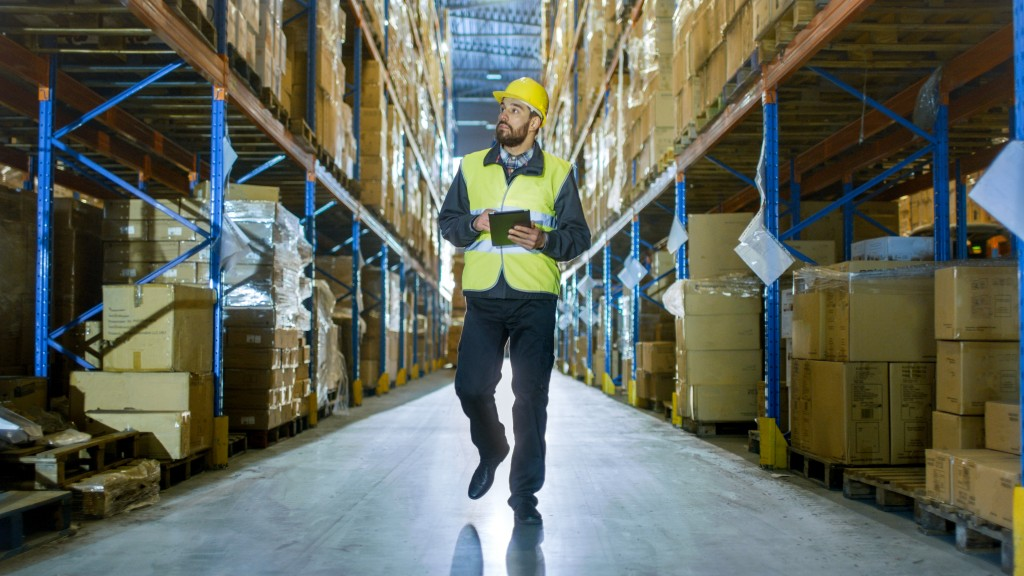 employee checking warehouse inventory