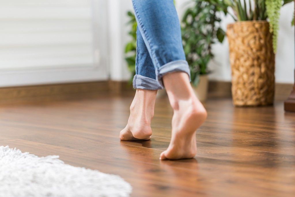 wood flooring with barefoot woman walking