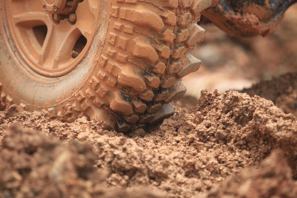 Wheel on dirt ground