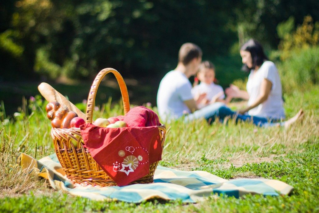 picnic basket and a family at the back
