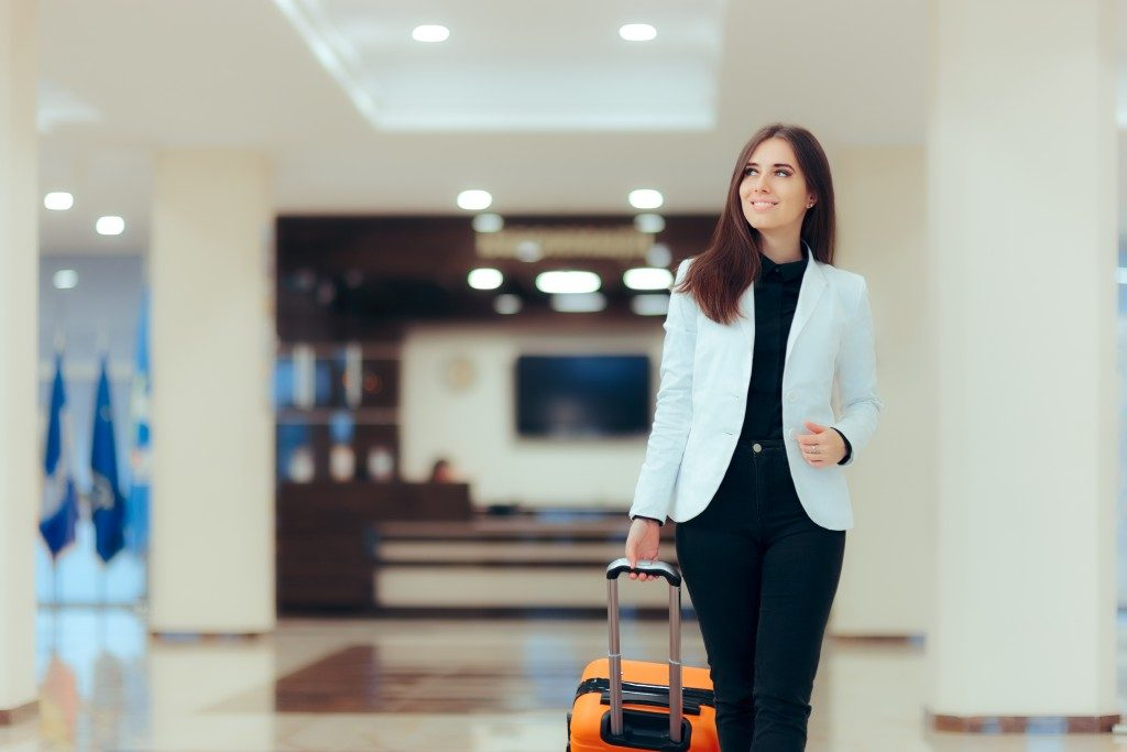 Woman walking in an airport with her luggage