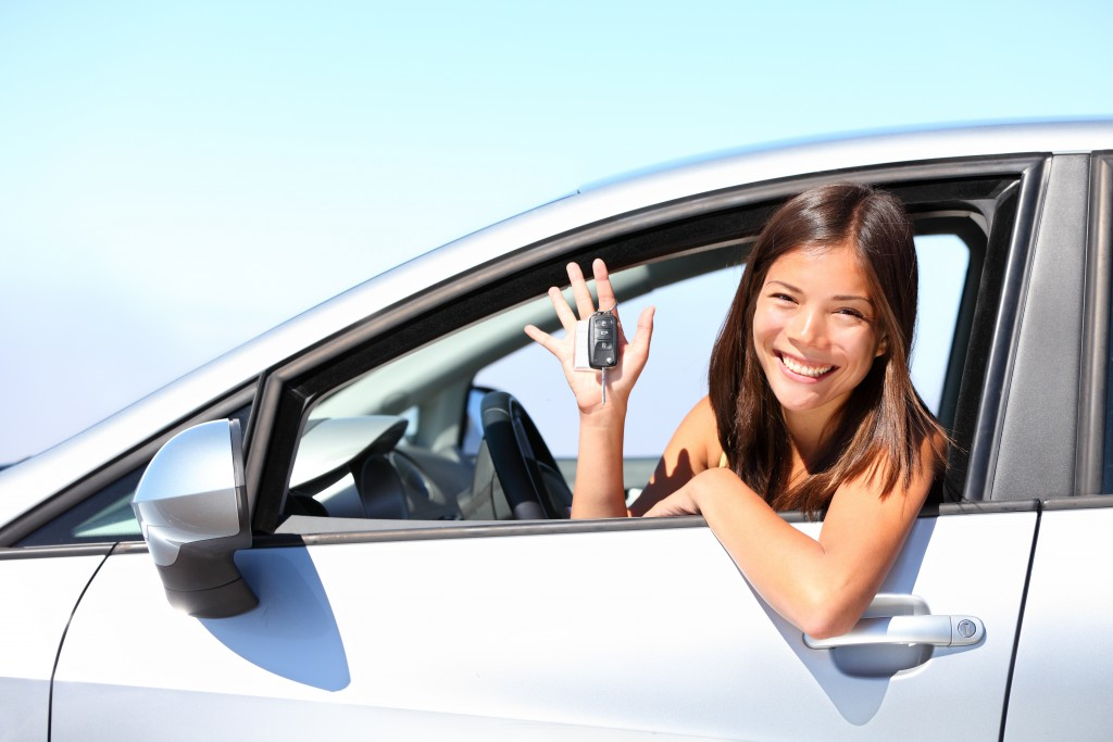 woman in her new car