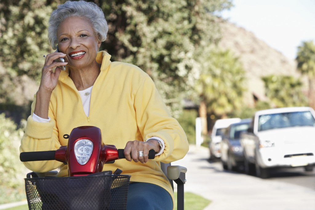 elderly woman on mobility aid