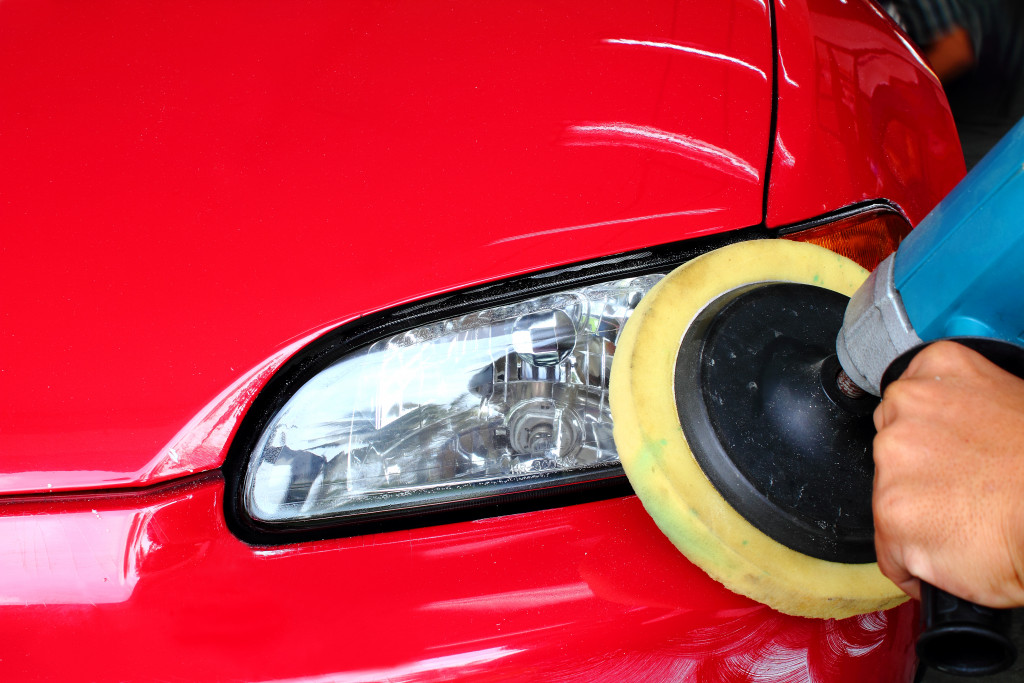 Close up of buffing red car