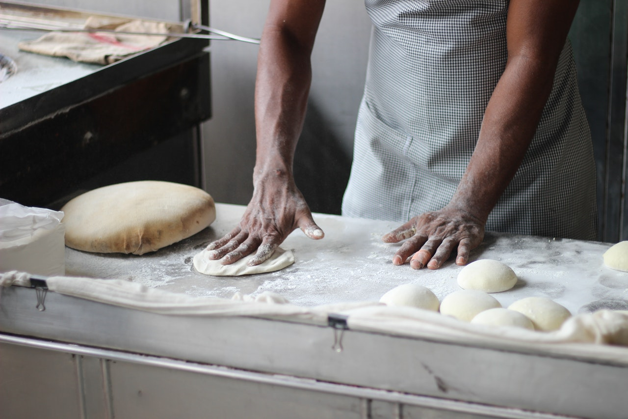 man preparing dough