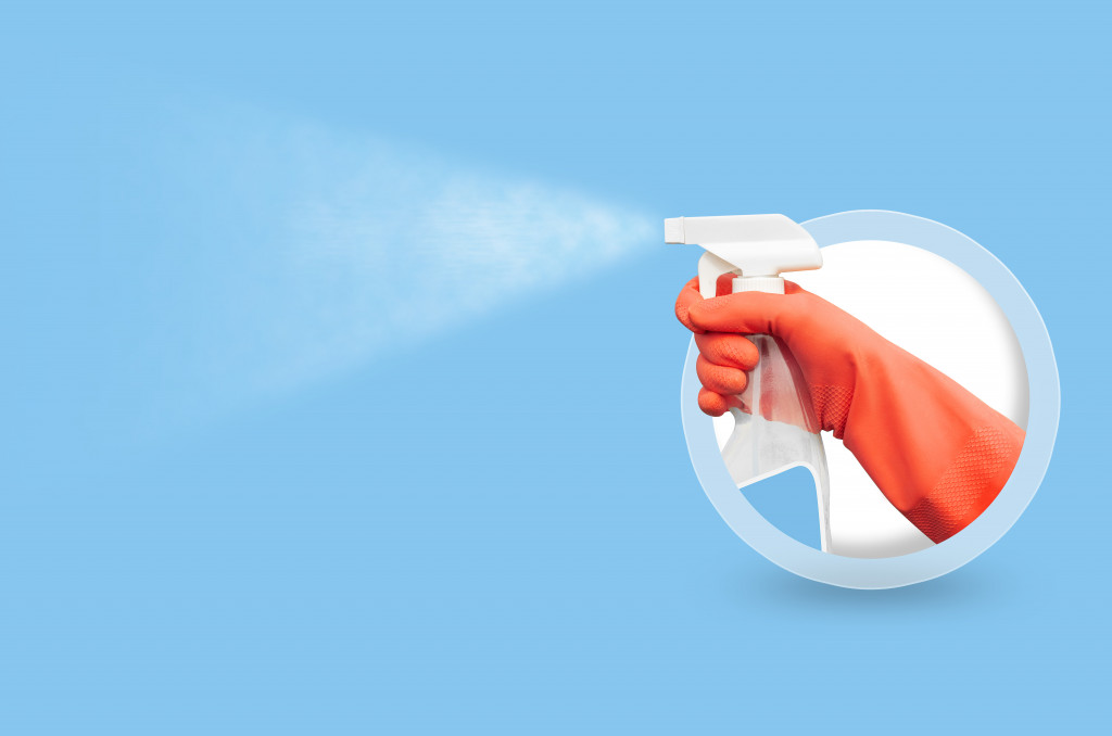 spraying a cleaning agent