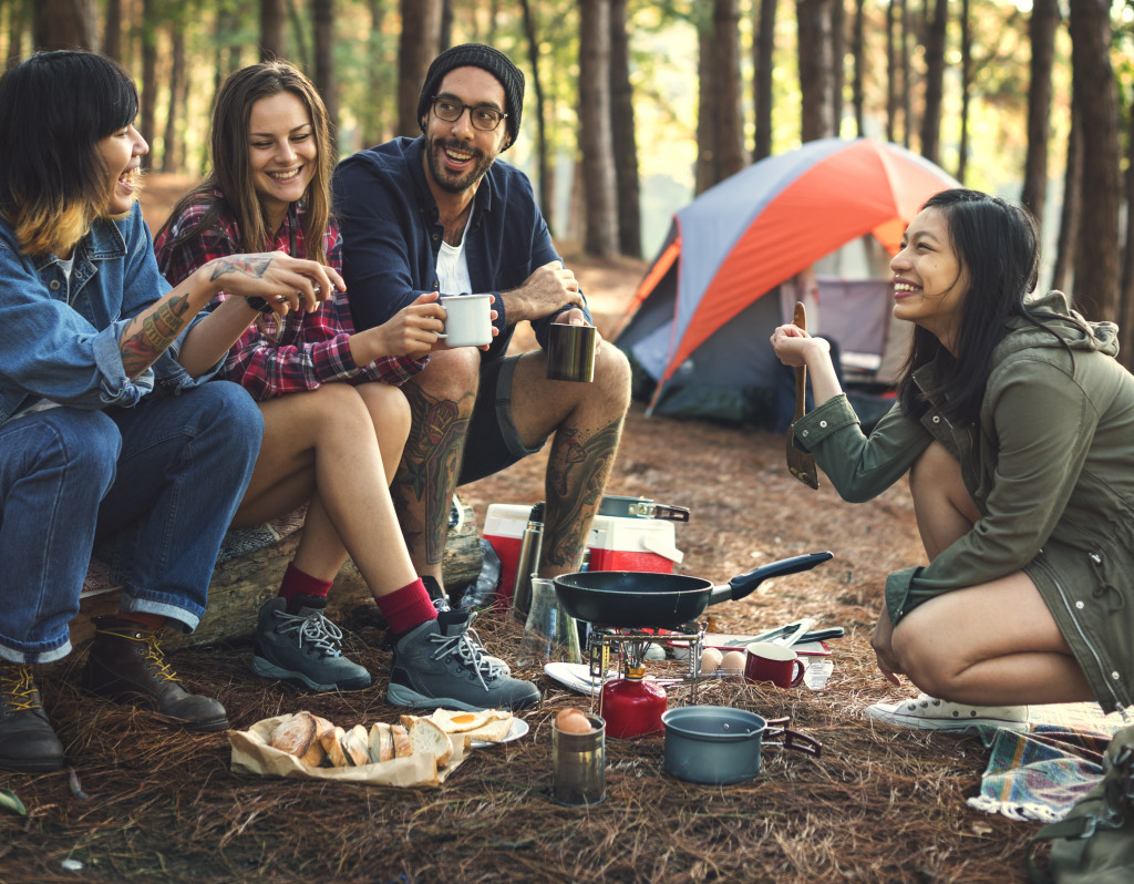 friends having coffee while camping