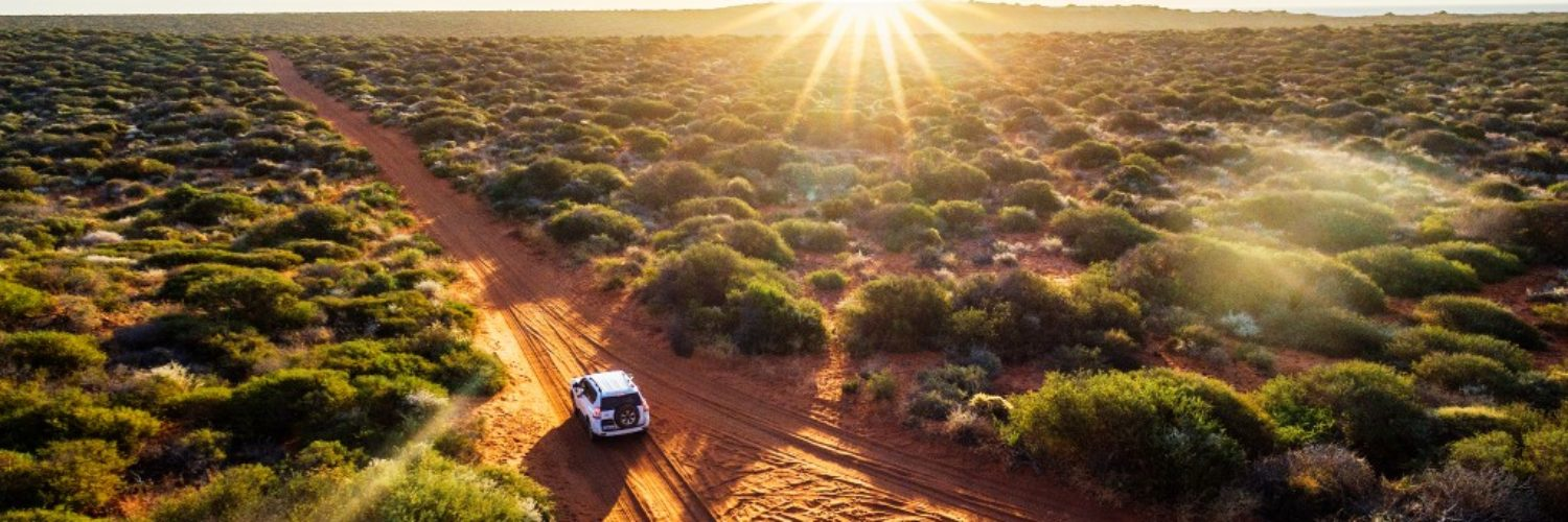 Australia, red sand unpaved road and 4x4 at sunset, Francoise Peron, Shark Bay