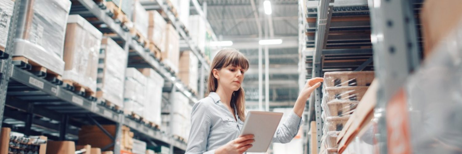 woman checking out stuff in the warehouse