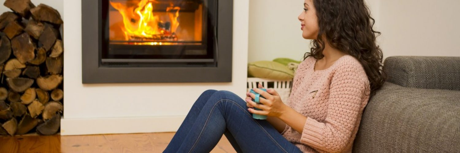 woman relaxing near the fireplace